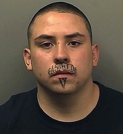 13 tattooed on his face as