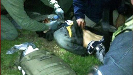Police arresting Boston Marathon bomber Dzhokhar Tsarnaev.