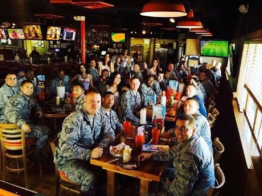 A group of military enjoy a free meal at Hooters.
