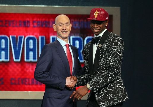 NBA boss Adam Silver, Andrew Wiggins, and Andrew Wiggins' suit.
