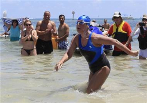 Diana Nyad wading ashore after a 110-mile swim.