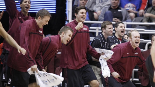 Harvard celebrates its first-ever NCAA tournament win.