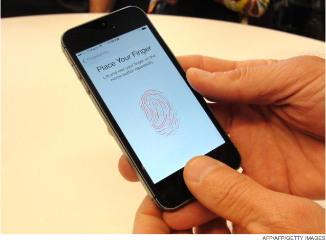 iPhone 5s Touch ID screen by AFP/AFP/GETTY Images