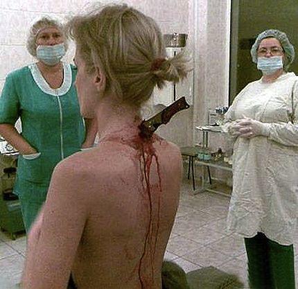 julia-popova-stabbed-in-shoulder.jpg