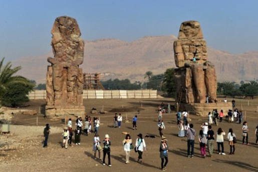 The Colossi of Memnon on the Nile River in Luxor, Egypt.