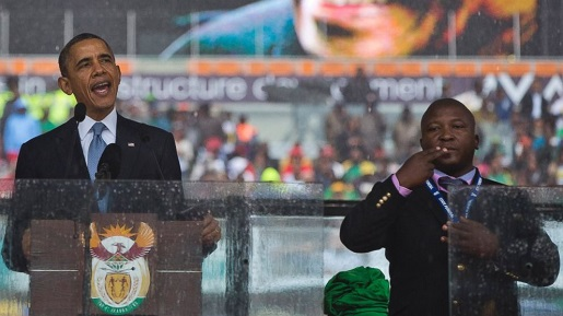 Pictured: President Obama and a fake sign language interpreter.