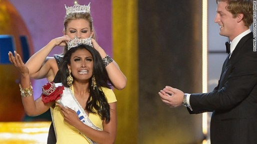 Newly-crowned Miss America Nina Davuluri celebrates with traditional pageant tears.
