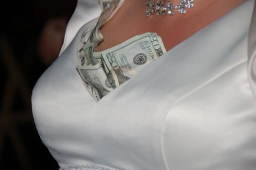money-stuffed-in-bra.jpg