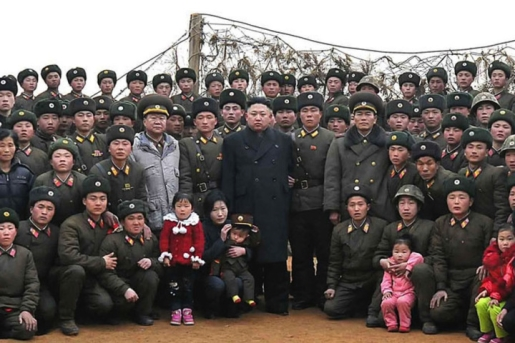 Kim Jong-Un and some North Korean troops, looking very happy.