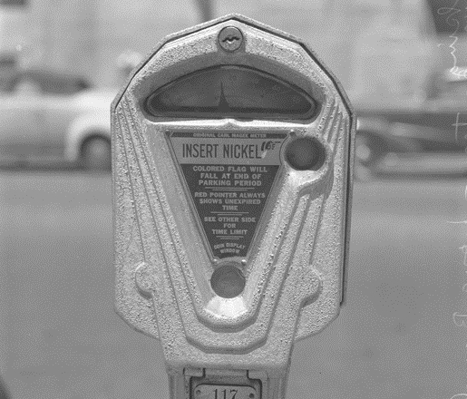 A parking meter in need of feeding.