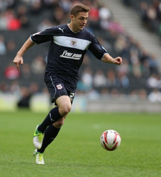 Robbie Rogers controlling the ball for Stevenage in England.