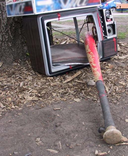 tv-smashed-with-bat.jpg