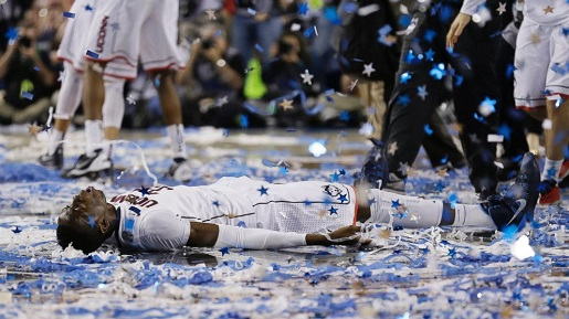 UConn's Amida Brimah makes a confetti angel.