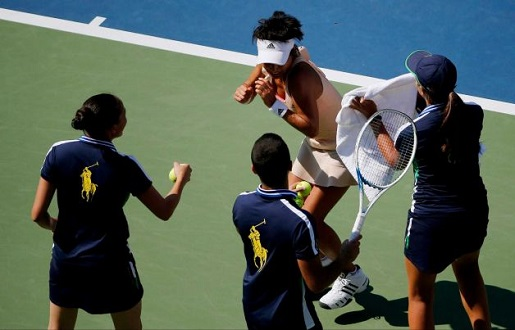 Kimiko Date-Krumm recoils during a bee capture attempt.